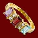 Prsten zlatý, ametyst, granát, modrý topaz, bílé topasy